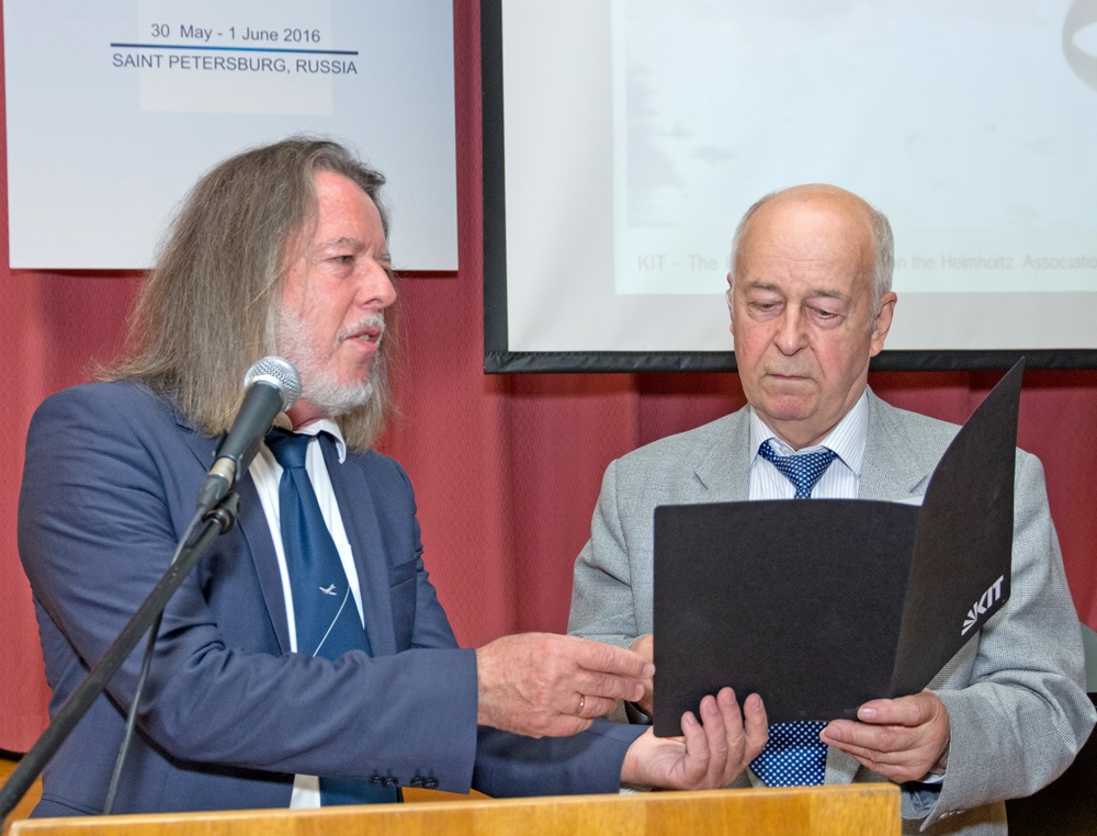Prof. G.Trommer (Germany) hands Certificate of Appreciation to Prof. D. Lukyanov (Russia)